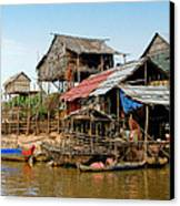 On The Shores Of Tonle Sap Canvas Print by Douglas J Fisher