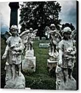 Parade Of Angels Statues At Cemetery Canvas Print by Amy Cicconi
