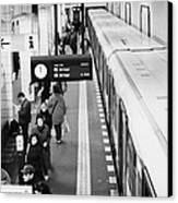 passengers along ubahn train platform Friedrichstrasse Friedrichstrasse u-bahn station Berlin Canvas Print by Joe Fox