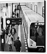 passengers on ubahn train platform as train leaves Friedrichstrasse u-bahn station Berlin Germany Canvas Print by Joe Fox