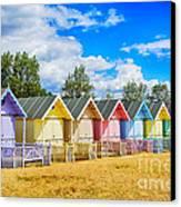 Pastel Beach Huts Canvas Print by Chris Thaxter