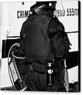 Psni Officer With Riot Gear On Crumlin Road At Ardoyne Shops Belfast 12th July Canvas Print by Joe Fox