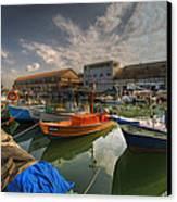 resting boats at the Jaffa port Canvas Print by Ron Shoshani