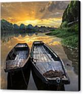 Rowboats On The River Canvas Print by Debra and Dave Vanderlaan
