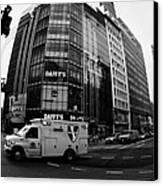 Saint Vincent Catholic Medical Centre Ambulance Crossing 6th Avenue And Broadway Canvas Print by Joe Fox