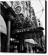 shoppers walk past entrance to Macys department store on Broadway and 34th street at Herald square Canvas Print by Joe Fox