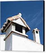 Spanish Rooftops Canvas Print by Anne Gilbert