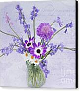 Spring Flowers In A Jam Jar Canvas Print by Ann Garrett