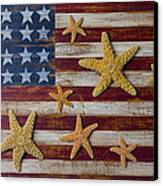 Starfish On American Flag Canvas Print by Garry Gay