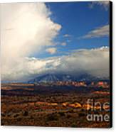 Storm Over The La Sals Canvas Print by Mike  Dawson