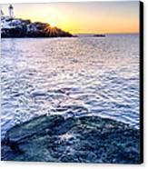 Sunrise Starburst Over Nubble Lighthouse  Canvas Print by Thomas Schoeller
