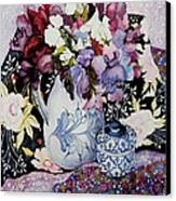Sweet Peas In A Blue And White Jug With Blue And White Pot And Textiles  Canvas Print by Joan Thewsey
