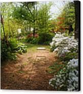 Swing In The Garden Canvas Print by Sandy Keeton