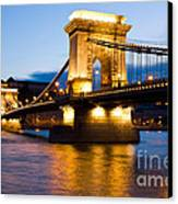 The Chain Bridge In Budapest Lit By The Street Lights Canvas Print by Kiril Stanchev
