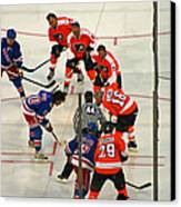 The Faceoff Canvas Print by David Rucker