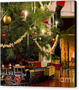Toy Train Under The Christmas Tree Canvas Print by Diane Diederich