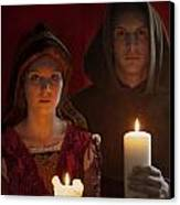 Tudor Medieval Young Attractive Couple  Holding  Candles Canvas Print by Lee Avison