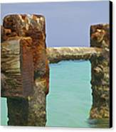 Twin Rusted Dock Piers Of The Caribbean Canvas Print by David Letts
