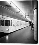 u-bahn train pulling in to ubahn station Berlin Germany Canvas Print by Joe Fox