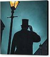 Victorian Man With Top Hat Under A Gas Lamp Canvas Print by Lee Avison