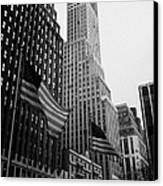 view of pennsylvania bldg nelson tower and US flags flying on 34th street from 1 penn plaza new york Canvas Print by Joe Fox