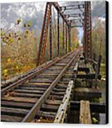 Waiting For The Train Canvas Print by Debra and Dave Vanderlaan