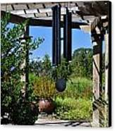 Wind Chime In A Garden Canvas Print by Mandy Judson