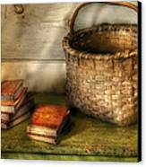 Writer - A Basket And Some Books Canvas Print by Mike Savad