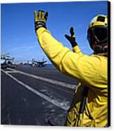 An Aviation Boatswains Mate Directs Canvas Print by Stocktrek Images