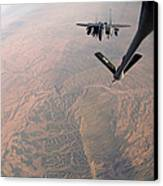 An F-15e Strike Eagle Is Refueled Canvas Print by Stocktrek Images