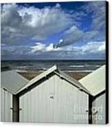 Beach Huts Under A Stormy Sky In Normandy Canvas Print by Bernard Jaubert