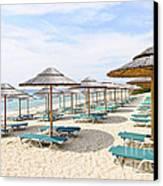 Beach Umbrellas On Sandy Seashore Canvas Print by Elena Elisseeva