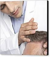 Hair Transplant Consultation Canvas Print by Adam Gault