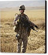 U.s. Marine Patrols A Wadi Near Kunduz Canvas Print by Terry Moore