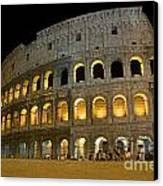 Coliseum Illuminated At Night. Rome Canvas Print by Bernard Jaubert