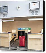 Luggage At An Airline Check-in Counter Canvas Print by Jaak Nilson