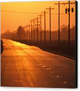 A Country Highway Fades Into The Sunset Canvas Print by Joel Sartore