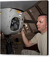 A Crew Chief Works On Mq-1 Predators Canvas Print by HIGH-G Productions