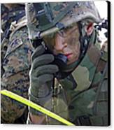 A Marine Communicates Over The Radio Canvas Print by Stocktrek Images