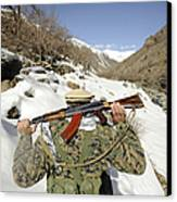 A Mujahadeen Guard Walks With U.s Canvas Print by Stocktrek Images