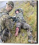 A Patrol Medic Applies First Aid Canvas Print by Andrew Chittock