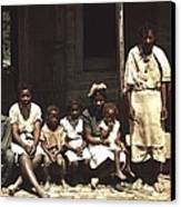 A Rural African American Family Seated Canvas Print by Everett