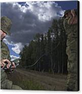 Airmen Use A Range Finder And Gps Unit Canvas Print by Stocktrek Images