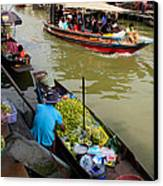 Ampawa Floating Market Canvas Print by Adrian Evans