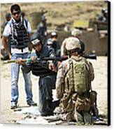 An Afghan Police Student Loads A Rpg-7 Canvas Print by Terry Moore