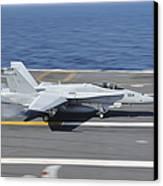 An Fa-18c Hornet Lands Aboard Uss Canvas Print by Stocktrek Images
