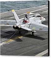 An Fa-18f Super Hornet Traps An Canvas Print by Stocktrek Images