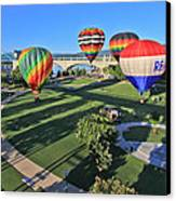 Balloons In Coolidge Park Canvas Print by Tom and Pat Cory