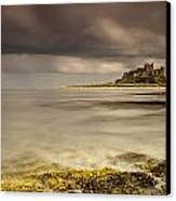 Bamburgh Castle Under A Cloudy Sky Canvas Print by John Short