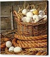 Basket Of Eggs On Straw Canvas Print by Sandra Cunningham